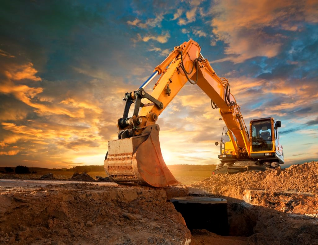 Preview, progressive and predictive dialling blog post header - an earth mover against a dramatic sunset.